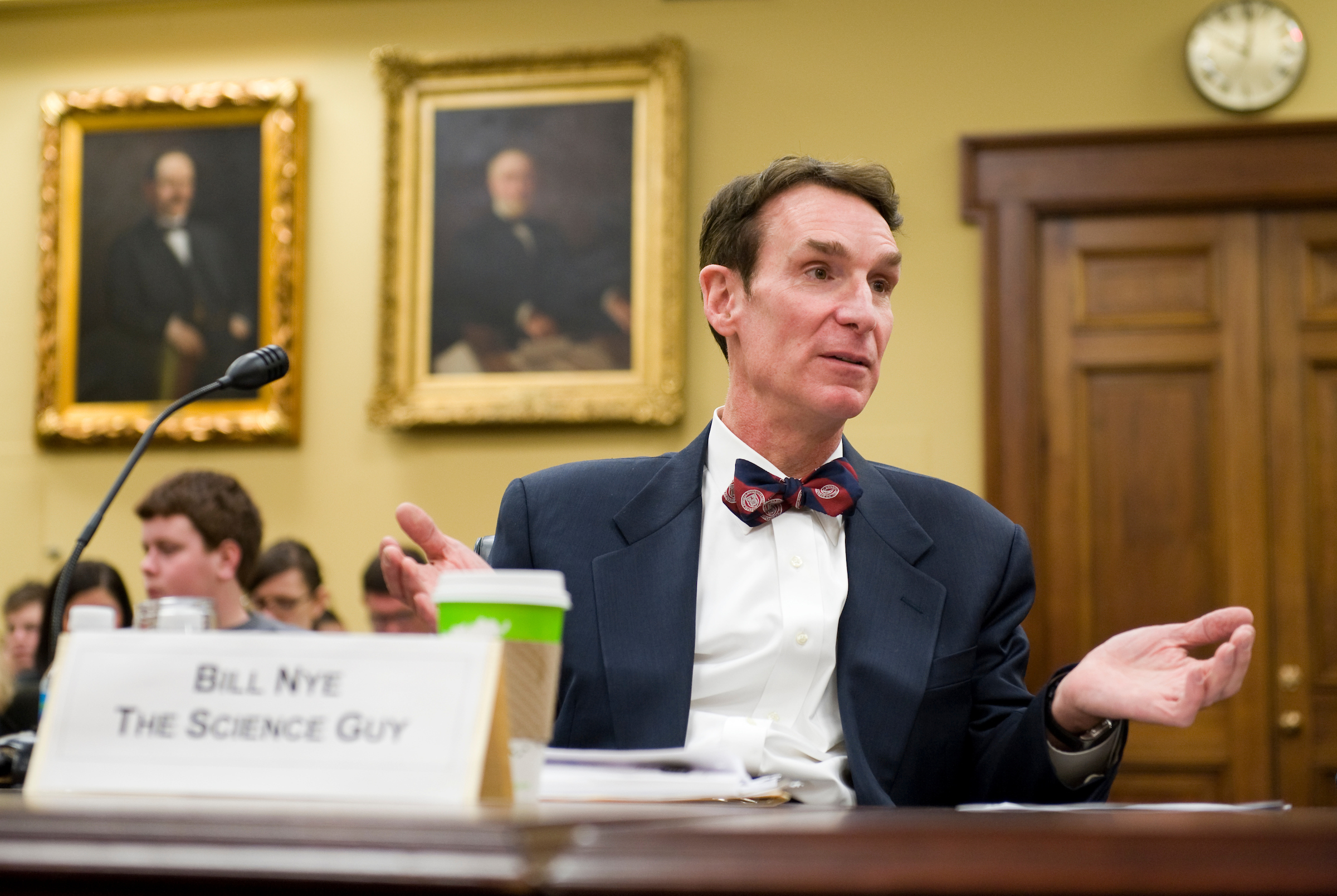 "Bill Nye ""The Science Guy,"" talks to another witness before the start of a House Appropriations subcommittee hearing on science education, March 5, 2009."