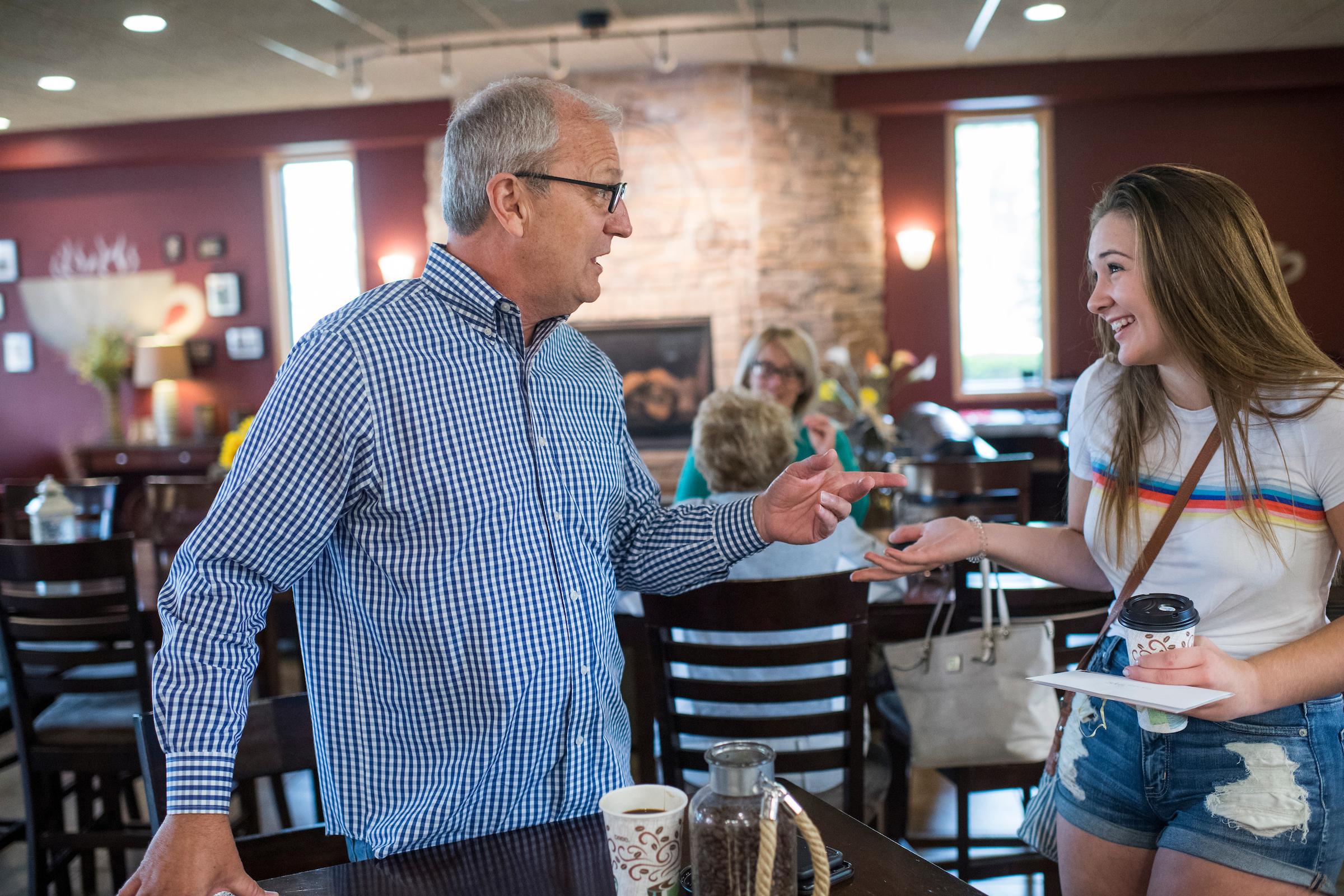 Rep. Kevin Cramer, R-N.D., talks with Sidney Larson, 18, at Boneshaker Coffee in Bismarck, N.D., on August 17, 2018. Cramer is running against Sen. Heidi Heitkamp, D-N.D., for the North Dakota Senate seat. (Photo By Tom Williams/CQ Roll Call)