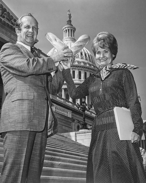 "First Tuesday in October in Kansas is ""Wheat Day"". Rep. Keith Sebelius, R-Kans., gives Rep. Margaret Heckler, R-Mass., two loaves of bread. She is on the Consumer and the Agriculture Committee. She gave up her spot on Banking and Currency to go on to the Agriculture Committee. 1981 (Photo by Mickey Senko/ CQ Roll Call)"
