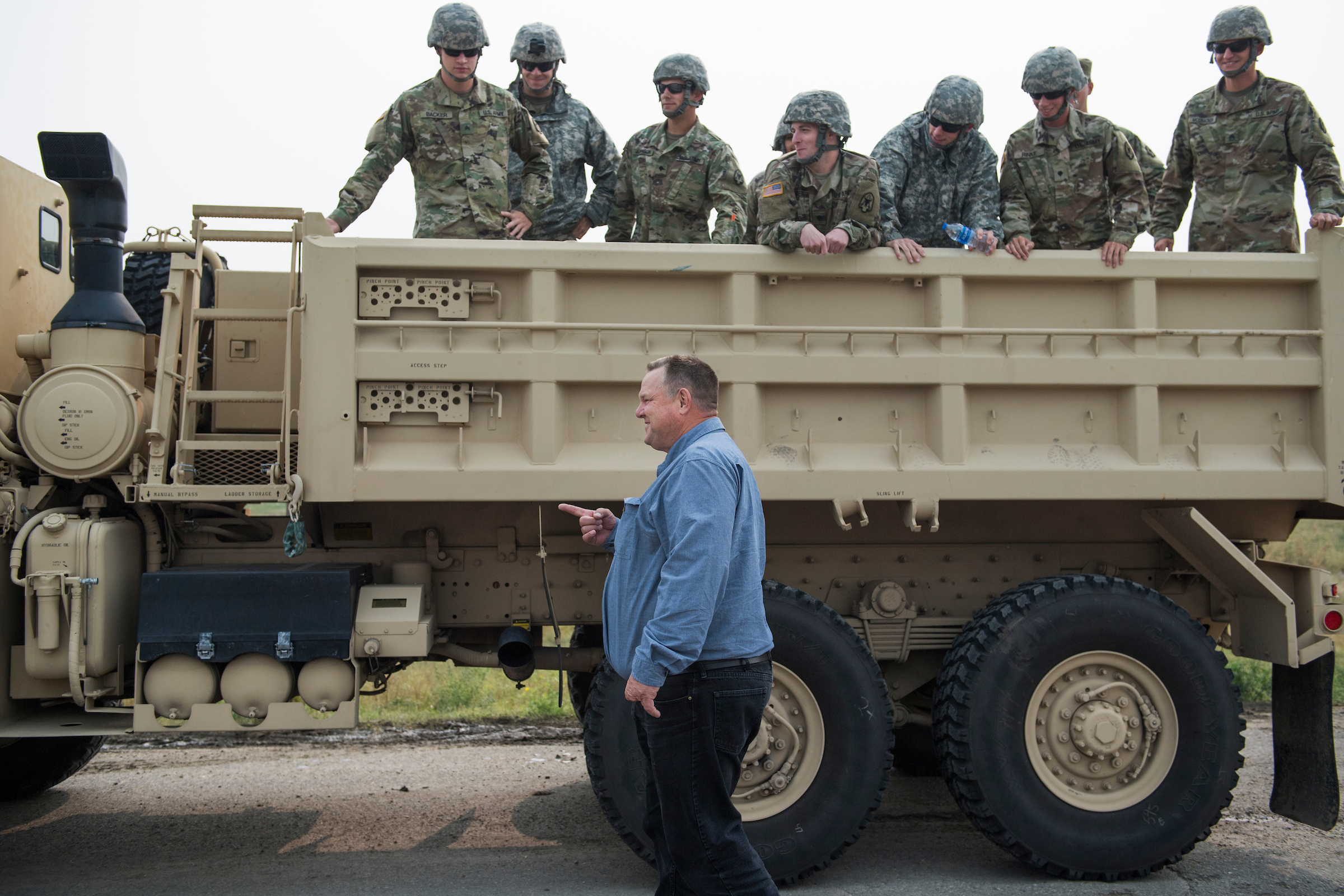UNITED STATES - AUGUST 19: Sen. Jon Tester, D-Mont., talks with service members before a parade at Crow Fair in Crow Agency, Mont., on August 19, 2018. Tester is being challenged by Republican Matt Rosendale for the Senate seat. (Photo By Tom Williams/CQ Roll Call)