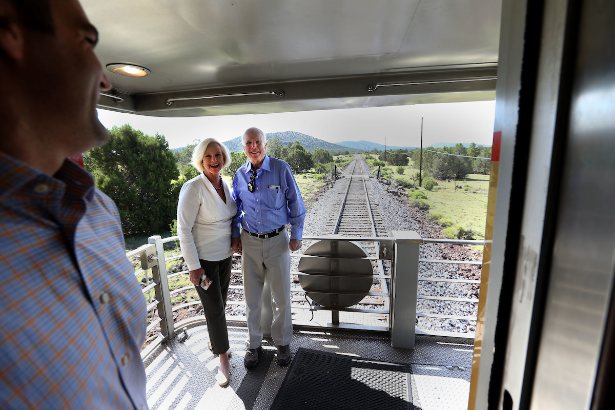 A Mc Cain staffer prepares to tweet an image out of United States Senator John Mc Cain and his wife Cindyas they ride the train to the Grand Canyon out of Williams Arizona Wednesday morning