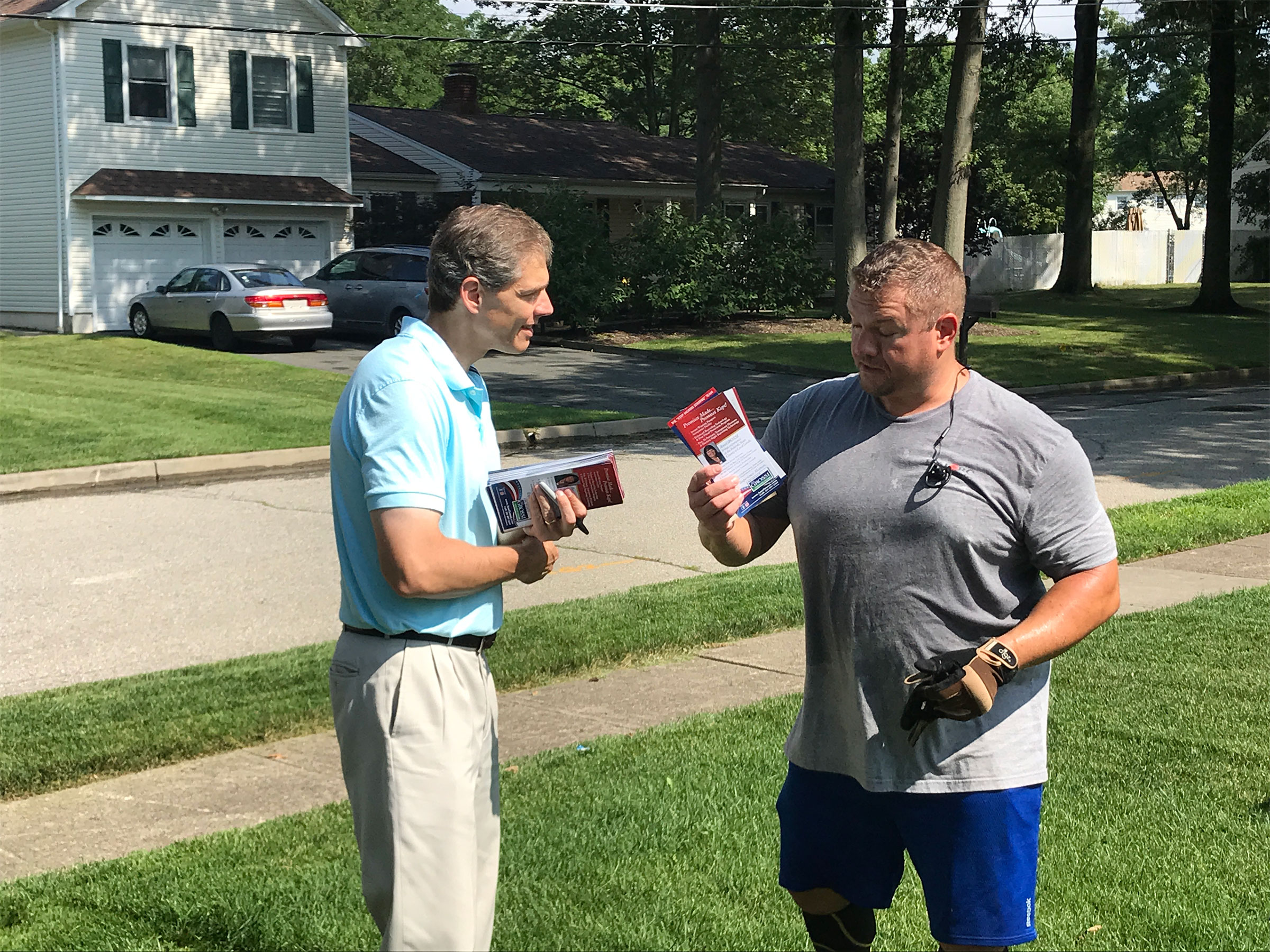 Republican state Assemblyman Jay Webber, left, who faces Sherrill in the fall, canvasses Saturday in Parsippany, N.J. (Simone Pathé/CQ Roll Call)