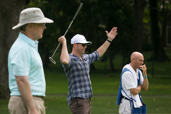 UNITED STATES - JULY 27: Rep. Duncan Hunter, R-Calif. celebrates as his teammates ball goes in the hole as Rep. Jim Cooper, D-Tenn., left, looks on at hole 7 during the First Tee Congressional Challenge golf tournament at the Columbia Country Club in Chevy Chase, Md., on Monday morning, July 27, 2015. (Photo By Al Drago/CQ Roll Call)