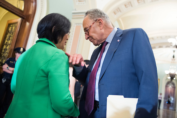 UNITED STATES - JULY 31: Senate Minority Leader Charles Schumer, D-N.Y., and Mazie Hirono, D-Hawaii, talk after the Senate Policy luncheons in the Capitol on July 31, 2018. (Photo By Tom Williams/CQ Roll Call)