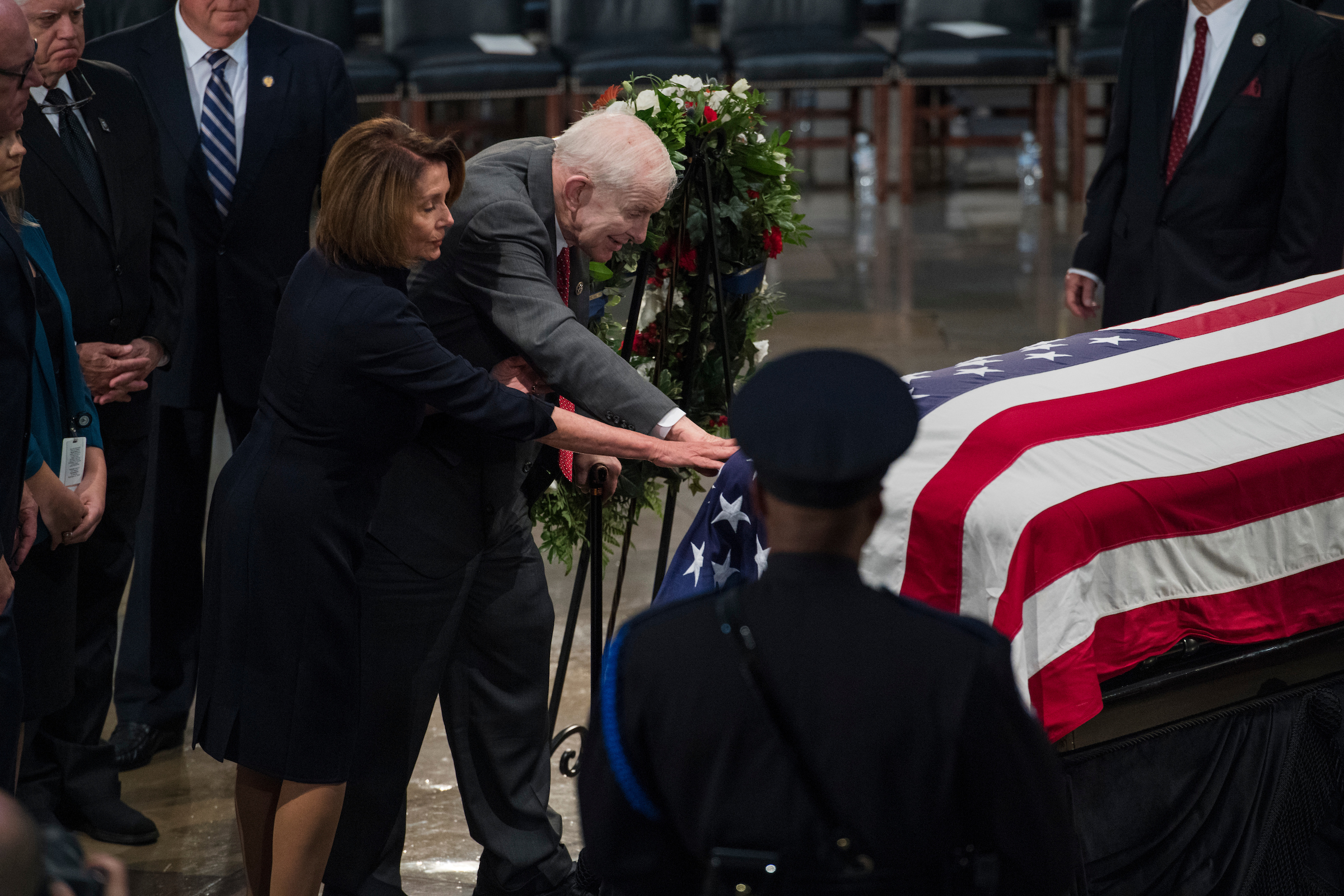 UNITED STATES - AUGUST 31: Rep. Sam Johnson, R-Texas, and House Minority Leader Nancy Pelosi, D-Calif., pay respects to the late Sen. John McCain, R-Ariz., as the senator lies in state in the Capitol rotunda on August 31, 2018. Johnson was also a prisoner of war during the Vietnam War. (Photo By Tom Williams/CQ Roll Call)