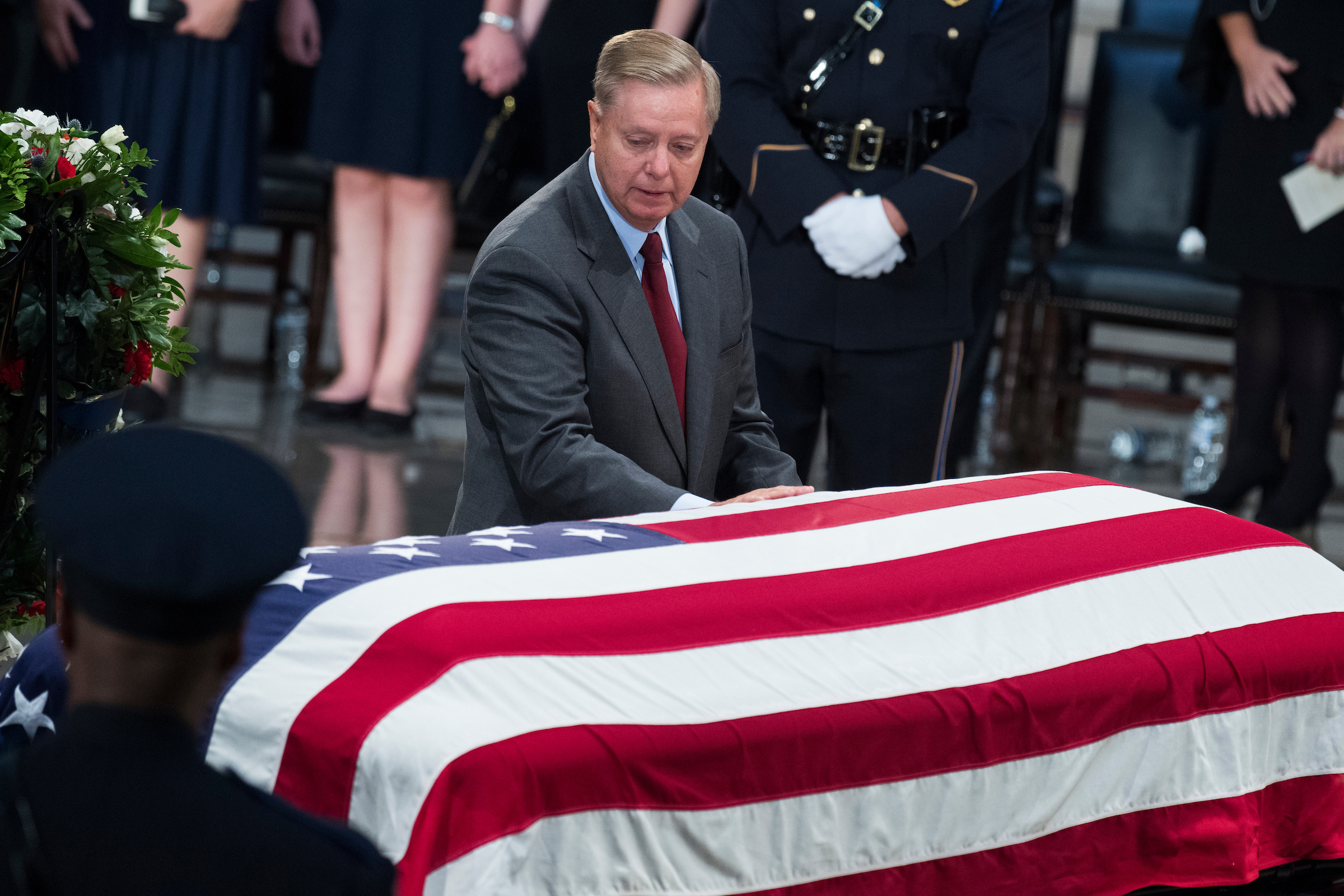 UNITED STATES - AUGUST 31: Sen. Lindsey Graham, R-S.C., pays respect to the late Sen. John McCain, R-Ariz., as the senator lies in state in the Capitol rotunda on August 31, 2018. (Photo By Tom Williams/CQ Roll Call)