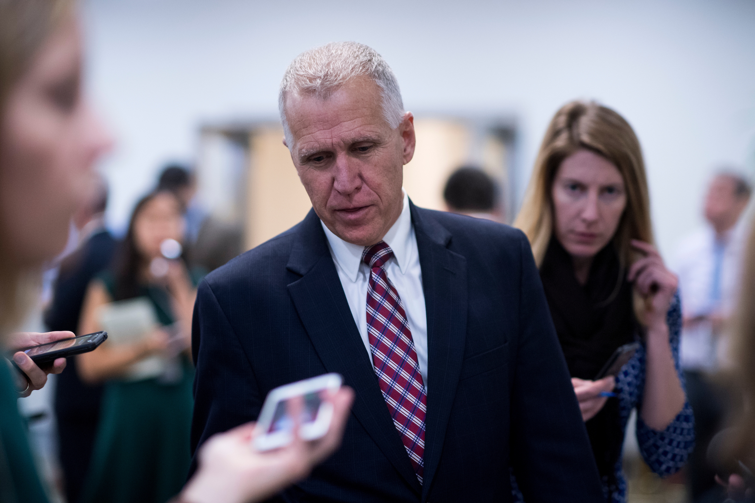 Sen. Thom Tillis, R-N.C., speaks with reporters as he arrives in the Capitol for the Senate Republicans' lunch with President Donald Trump on Tuesday, Nov. 28, 2017. (Photo By Bill Clark/CQ Roll Call)