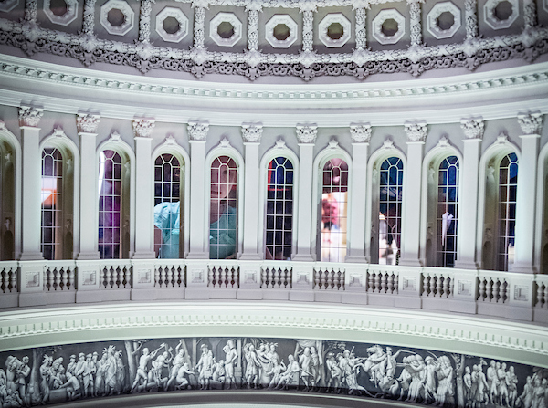 UNITED STATES - SEPT 10: A little girl and a man look through the windows of the Capitol dome miniature model in the Capitol Visitors Center Monday afternoon Sept. 10, 2018. (Photo By Sarah Silbiger/CQ Roll Call)