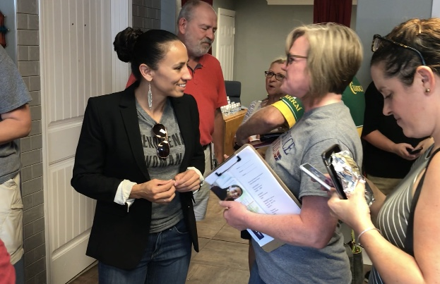 Davids, left, greets a volunteer at her office in Kansas City. (Bridget Bowman/CQ Roll Call)