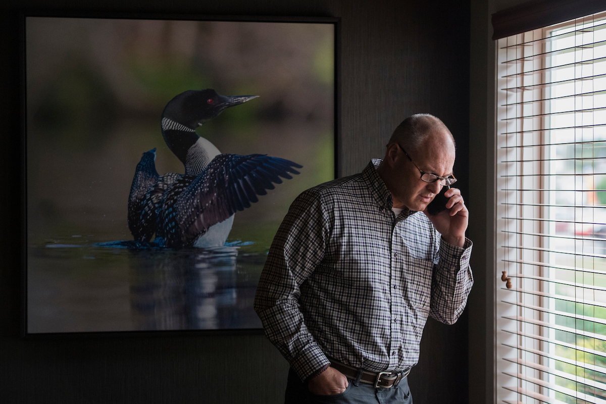 UNITED STATES - SEPTEMBER 18: Pete Stauber, Republican candidate for Minnesota's 8th Congressional District, talks on the phone during a meet and greet with local GOP politicians in Park Rapids, Minn., on September 18, 2018. (Photo By Tom Williams/CQ Roll Call)