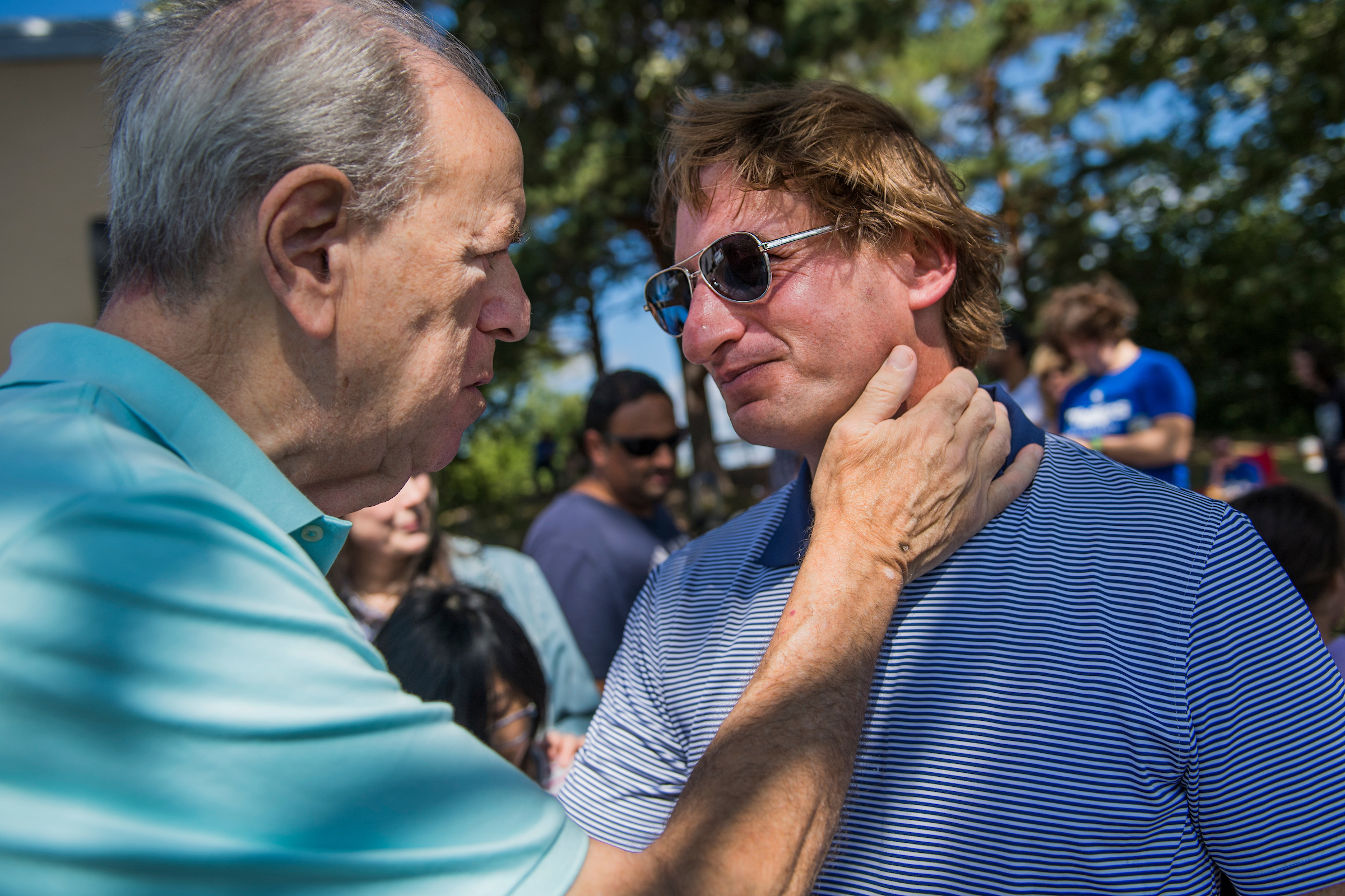"UNITED STATES - SEPTEMBER 15: Dean Phillips, right, Democratic candidate for Minnesota's 3rd Congressional District, talks with Jeff Halpern, at the ""Everyone's Invited!"" picnic in Excelsior, Minn., on September 15, 2018. (Photo By Tom Williams/CQ Roll Call)"