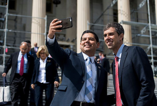 Rep. Raul Ruiz, D-Calif., takes a selfie with Rep. Beto O'Rourke, D-Texas, on the House steps of the Capitol after the final votes of the week on Friday. (Bill Clark/CQ Roll Call)