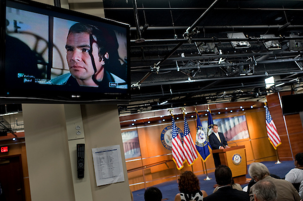 """UNITED STATES - JULY 21: The movie """"The Longest Yard,"""" plays on a television during the weekly news conference of Speaker John Boehner, R-Ohio, in the Capitol Visitor Center where he mainly addressed the debt ceiling talks. (Photo By Tom Williams/Roll Call)"""