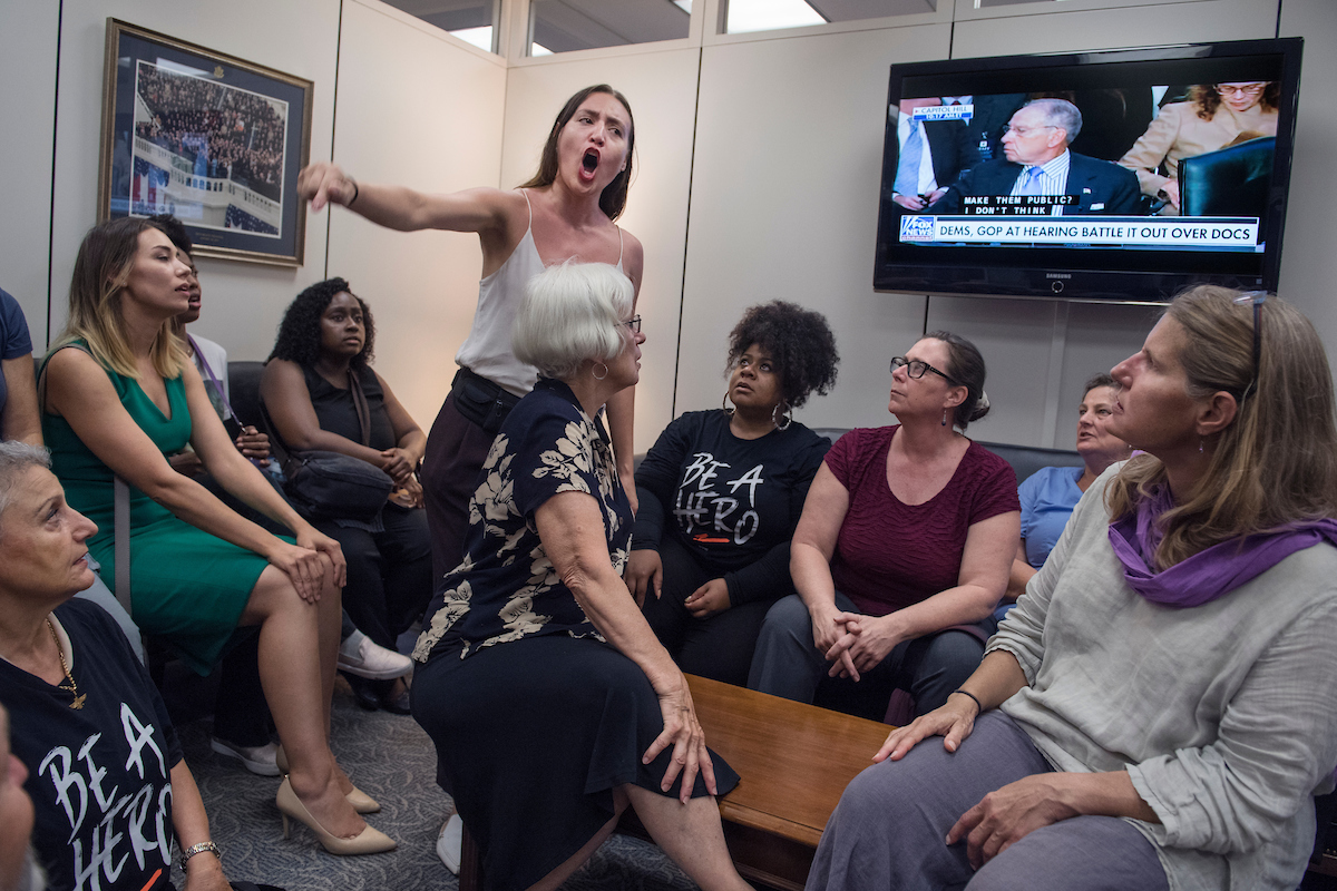 Protesters, including Breanne Butler, standing, occupy the Hart Building office of Senate Judiciary Committee Chairman Charles Grassley, R-Iowa, to oppose the nomination of Supreme Court nominee Brett Kavanaugh. (Photo By Tom Williams/CQ Roll Call)
