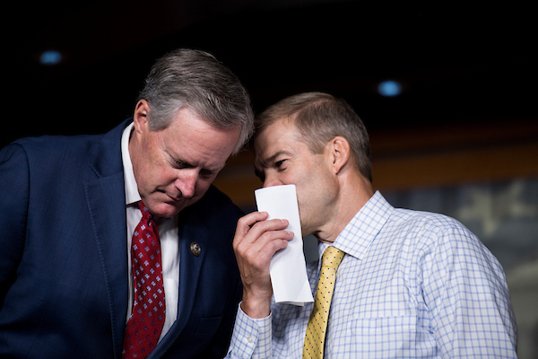 UNITED STATES - SEPTEMBER 6: Rep. Mark Meadows, R-N.C., left, and Rep. Jim Jordan, R-Ohio, talk during the press conference calling on President Trump to declassify the Carter Page FISA applications on Thursday, Sept. 6, 2018. (Photo By Bill Clark/CQ Roll Call)