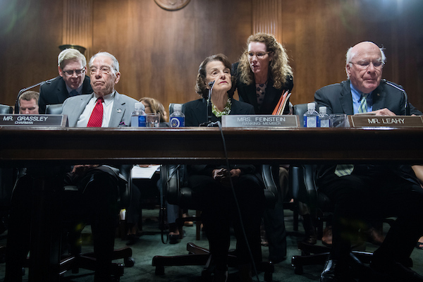 UNITED STATES - SEPTEMBER 13: From left, Chairman Charles Grassley, R-Iowa, ranking member Sen. Dianne Feinstein, D-Calif., and Sen. Patrick Leahy, D-Vt., conduct a markup of the Senate Judiciary Committee in Dirksen Building on September 13, 2018, where Republicans voted to move the committee vote on Supreme Court nominee Brett Kavanaugh to September 20th. (Photo By Tom Williams/CQ Roll Call)