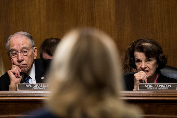 UNITED STATES - SEPTEMBER 27: Sen. Chuck Grassley, R-Iowa, and Sen. Dianne Feinstein, D-Calif., listen as Dr. Christine Blasey Ford testifies during the Senate Judiciary Committee hearing on the nomination of Brett M. Kavanaugh to be an associate justice of the Supreme Court of the United States, focusing on allegations of sexual assault by Kavanaugh against Christine Blasey Ford in the early 1980s. (Photo By Tom Williams/CQ Roll Call/POOL)