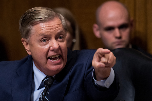 UNITED STATES - SEPTEMBER 27: Sen. Lindsey Graham, R-S.C., points at the Democrats as he defends Judge Brett Kavanaugh during the Senate Judiciary Committee hearing on his nomination be an associate justice of the Supreme Court of the United States, focusing on allegations of sexual assault by Kavanaugh against Christine Blasey Ford in the early 1980s. (Photo By Tom Williams/CQ Roll Call/POOL)