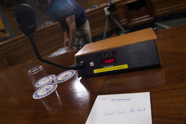 UNITED STATES - SEPTEMBER 26: A note of encouragement for Dr. Christine Blasey Ford appears on a pad in the Senate Judiciary Committee hearing room on September 26, 2018, in Dirksen Building before her testimony about alleged sexual misconduct by Supreme Court nominee Brett Kavanaugh. (Photo By Tom Williams/CQ Roll Call)