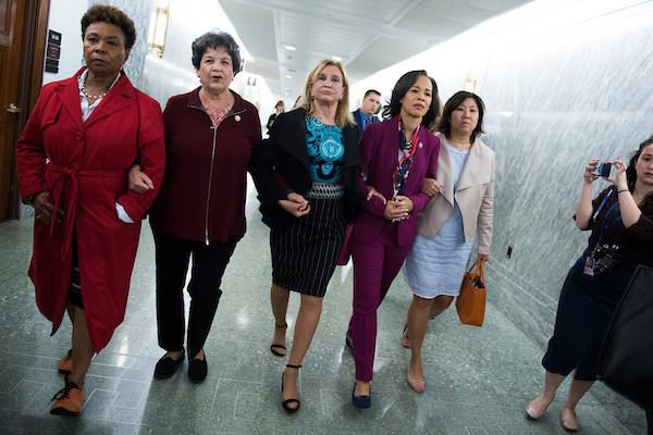 Some House members who oppose the nomination of the Supreme Court nominee Brett Kavanaugh, make their way Friday to Senate Judiciary Committee room. From left, Reps. Barbara Lee, D-Texas, Lois Frankel, D-Fla., Carolyn Maloney, D-N.Y., Lisa Blunt Rochester, D-Del., Grace Meng, D-N.Y. (Tom Williams/CQ Roll Call)