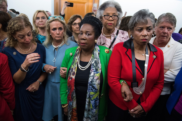 Members of the House of Representatives, who oppose the nomination of the Supreme Court associate justice nominee Brett Kavanaugh, wait to enter the Senate Judiciary Committee vote in Dirksen Building on his nomination on September 28, 2018. From left are, Reps. Debbie Wasserman Schultz, D-Fla., Carolyn Maloney, D-N.Y., Debbie Dingell, D-Mich., Suzanne Bonamici, D-Ore., Sheila Jackson Lee, R-Texas, Joyce Beatty, D-Ohio, Brenda Lawrence, D-Mich., and Julia Brownley, D-Calif. (Tom Williams/CQ Roll Call)
