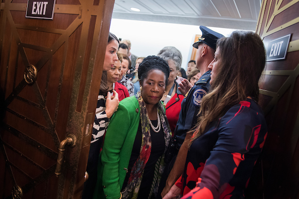 Rep. Sheila Jackson Lee, R-Texas, and others make their way into the Dirksen Senate Office Building on Friday. (Tom Williams/CQ Roll Call)