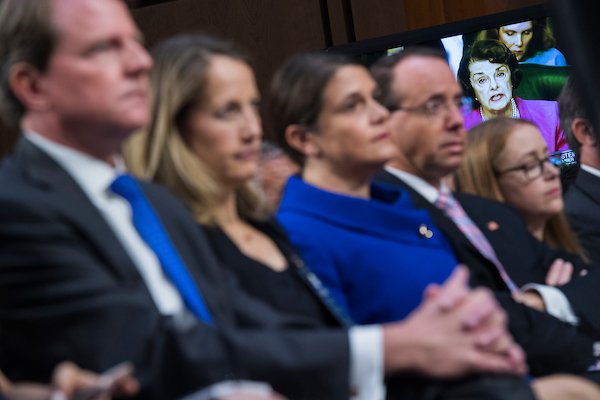 UNITED STATES - SEPTEMBER 04: Ranking member Sen. Dianne Feinstein, D-Calif., makes a statement as Deputy Attorney General Rod Rosenstein, second from right, and White House counsel Don McGahn, left, look on, during the Senate Judiciary Committee confirmation hearing for Supreme Court nominee Brett Kavanaugh in Hart Building on September 4, 2018. The hearing was delayed by motions to adjourn by Democratic senators and protesters. (Photo By Tom Williams/CQ Roll Call)