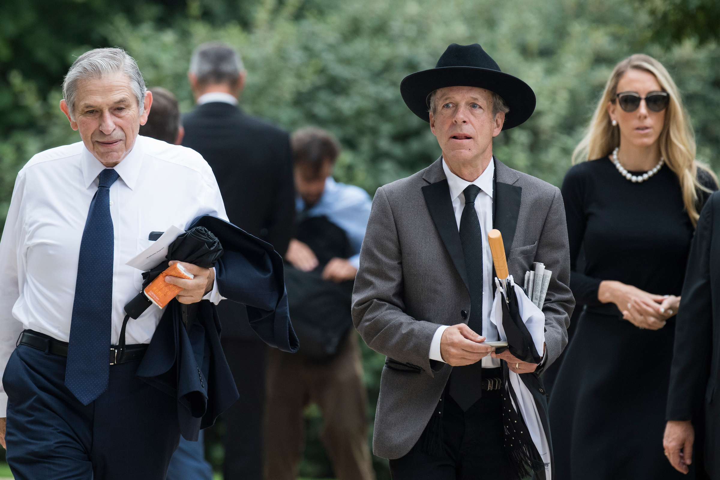 UNITED STATES - SEPTEMBER 1: Mark Mckinnon, right, and Paul Wolfowitz, former deputy secretary of defense, arrive for the funeral of the late Sen. John McCain, R-Ariz., at the Washington National Cathedral on September 1, 2018. (Photo By Tom Williams/CQ Roll Call)
