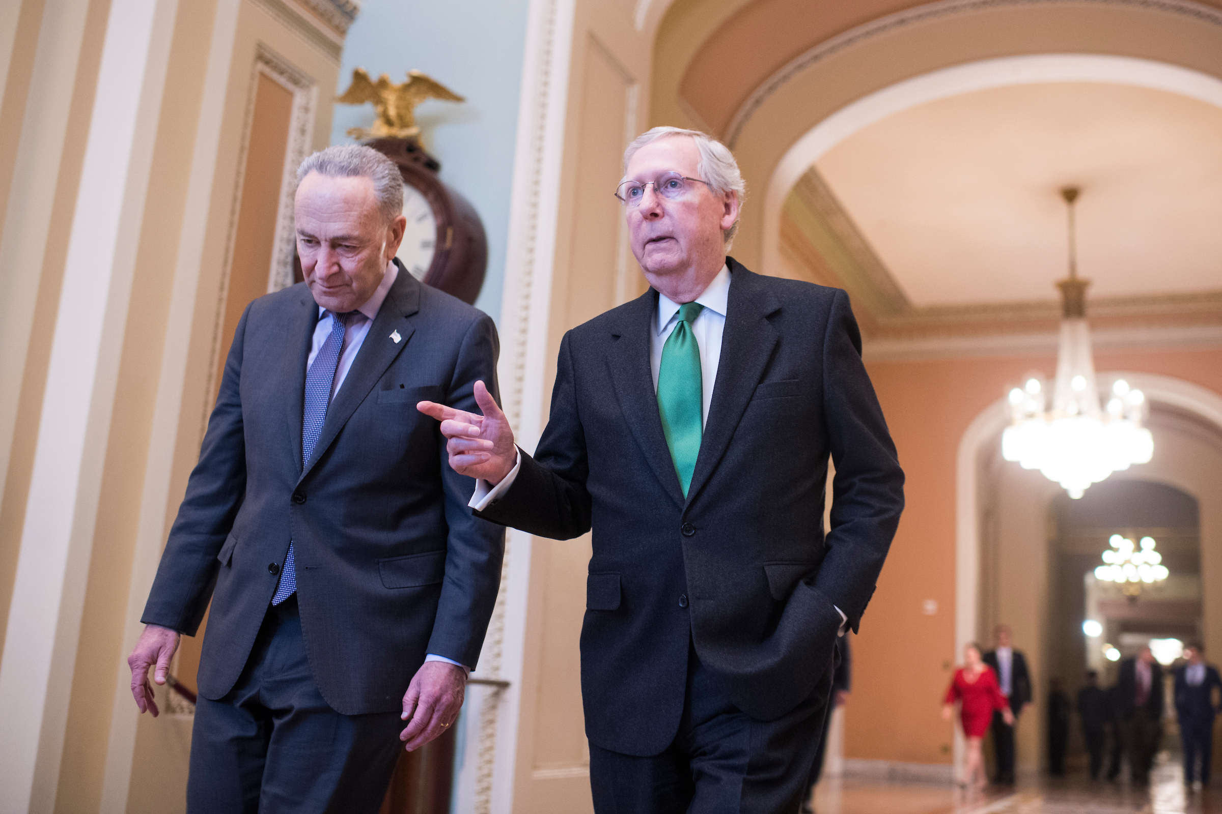 UNITED STATES - FEBRUARY 07: Senate Majority Leader Mitch McConnell, R-Ky., right, and Senate Minority Leader Charles Schumer, D-N.Y., make their way to the Senate floor after announcing a two-year deal on the budget earlier in the day on February 7, 2018. (Photo By Tom Williams/CQ Roll Call)