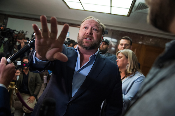 UNITED STATES - SEPTEMBER 05: Alex Jones of Infowars, holds a news conference in Dirksen Building outside a Senate (Select) Intelligence Committee hearing where Sheryl Sandberg, Facebook COO, and Jack Dorsey, Twitter CEO, were testifying on the influence of foreign operations on social media on September 5, 2018. Jones has recently been banned from social media platforms. (Photo By Tom Williams/CQ Roll Call)