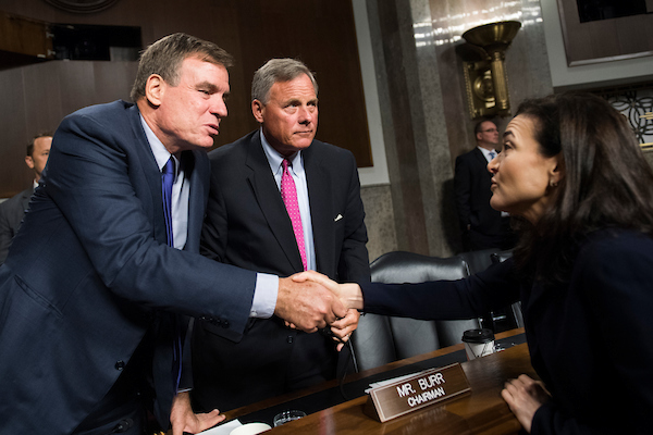 UNITED STATES - SEPTEMBER 05: Sheryl Sandberg, Facebook COO, greets Vice Chairman Sen. Mark Warner, D-Va., left, and Chairman Richard Burr, R-N.C., after a Senate (Select) Intelligence Committee hearing in Dirksen Building where she and Jack Dorsey, Twitter CEO, testified on the influence of foreign operations on social media on September 5, 2018. (Photo By Tom Williams/CQ Roll Call)