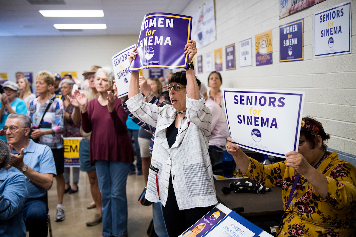 Supporters cheer as Democratic candidate for U.S. Senate Rep. Kyrsten Sinema, D-Ariz., arrives to at a union hall in Tucson. (Bill Clark/CQ Roll Call)