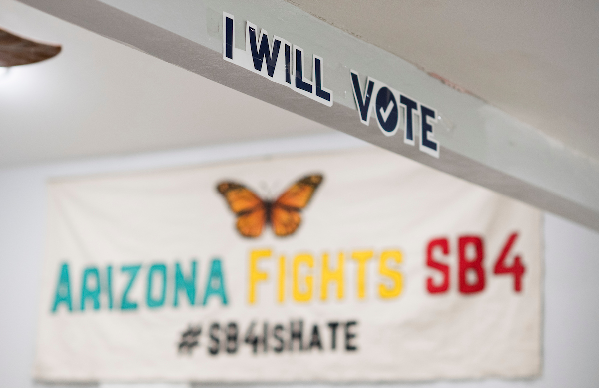 Signs hang in the offices of LUCHA, Living United for Change in Arizona, in Phoenix. (Bill Clark/CQ Roll Call)