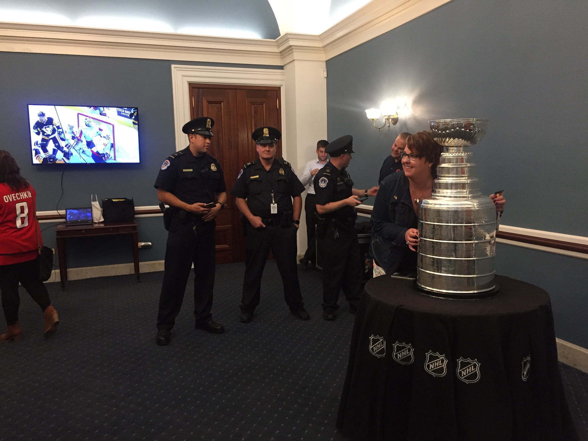 A television screen played Washington Capitals' highlights while the Cup sat in the Capitol. (Alex Gangitano/CQ Roll Call)