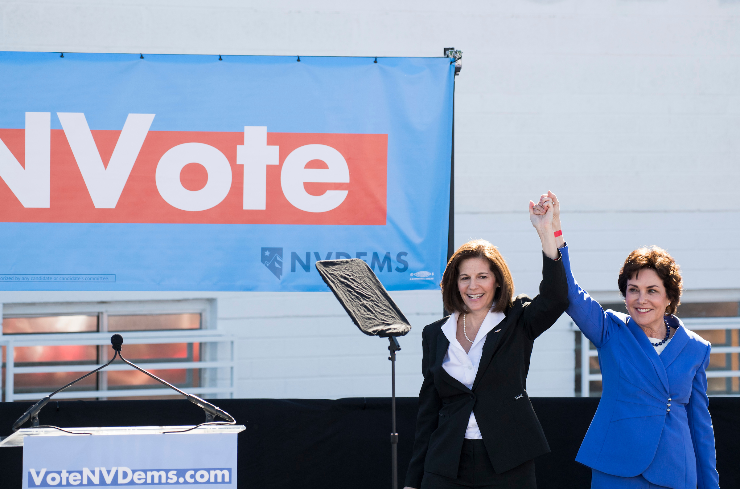 Sen. Catherine Cortez Masto, D-Nev., left, and Democratic candidate for Senate Rep. Jacky Rosen, D-Nev.,hold hands up in the air at the Nevada Democrats' early vote rally, which featured former Vice President Joe Biden, at the Culinary Workers Union Local 226 in Las Vegas on Saturday, Oct. 20, 2018, the first day of early voting in Nevada. (Photo By Bill Clark/CQ Roll Call)