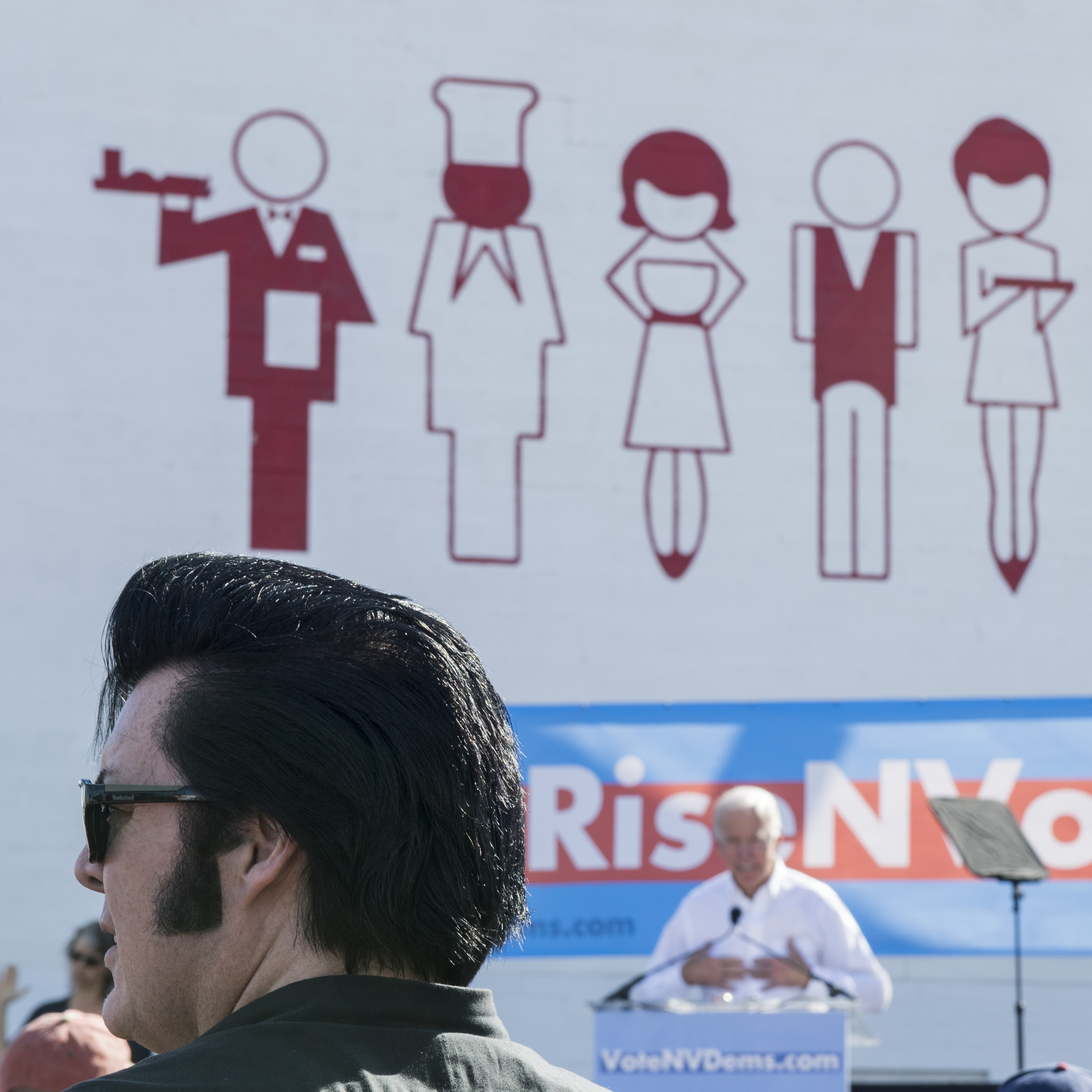 UNITED STATES - OCTOBER 20: An Elvis impersonator looks on as former Vice President Joe Biden speaks at the Nevada Democrats' early vote rally at the Culinary Workers Union Local 226 in Las Vegas on Saturday, Oct. 20, 2018, the first day of early voting in Nevada. (Photo By Bill Clark/CQ Roll Call)