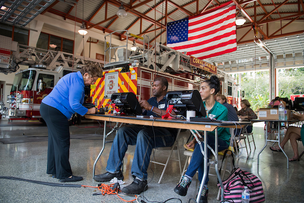 UNITED STATES - NOVEMBER 3: Donna Shalala, left, Democratic candidate for Florida's 27th Congressional District, signs in upon arriving to vote on Election Day at Coral Gables Fire Station 3 on November 6, 2018. (Photo By Tom Williams/CQ Roll Call)