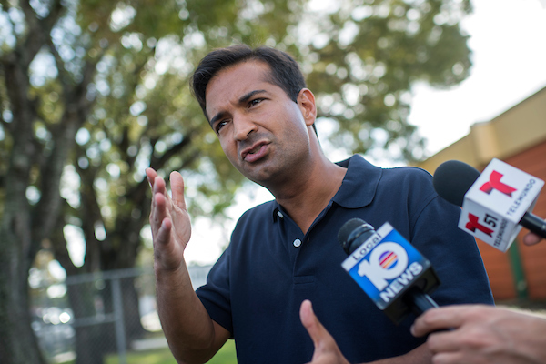 Curbelo talks with media outside a polling facility. (Tom Williams/CQ Roll Call)
