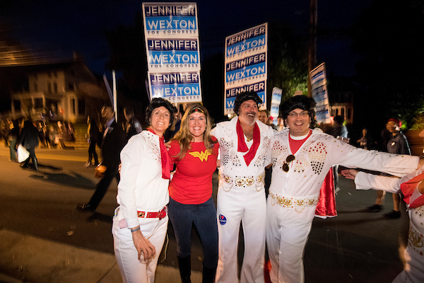 UNITED STATES - OCTOBER 31: Jennifer Wexton, the Democrat challenging Rep. Barabra Comostock in Virginia's 10th district, stops for a photo with a group of supporters dressed up as Elvis during the 62nd Annual Kiwanis Halloween Parade in Leesburg, Va., on Wednesday, Oct. 31, 2018. (Photo By Bill Clark/CQ Roll Call)