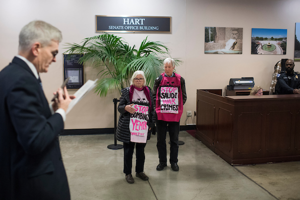 UNITED STATES - NOVEMBER 28: Demonstrators from Code Pink protest Saudi Arabia's war in Yemen as Sen. Bill Cassidy, R-La., walks by in the basement of Hart Building on November 28, 2018. (Photo By Tom Williams/CQ Roll Call)