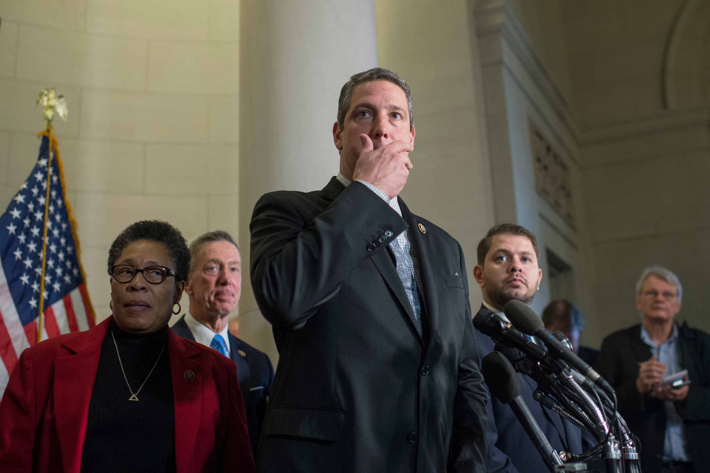 UNITED STATES - NOVEMBER 30: Rep. Tim Ryan, D-Ohio, a podium,  speaks with the media in Longworth Building after losing the race for Democratic leader to House Minority Leader Nancy Pelosi, D-Calif., November 30, 2016. Also Appearing are, from left, Reps. Marcia Fudge, D-Ohio, Stephen Lynch, D-Mass., and Ruben Gallego, D-Ariz. (Photo By Tom Williams/CQ Roll Call)