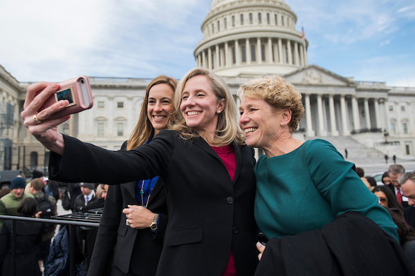 UNITED STATES - NOVEMBER 14: Members-elect from left, Mikie Sherrill, D-N.J., Abigail Spanberger, D-Va., and Chrissy Houlahan, D-Pa., take a selfie after the freshman class photo on the East Front of the Capitol on November 14, 2018. (Photo By Tom Williams/CQ Roll Call)