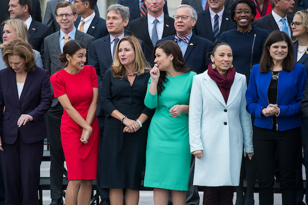 UNITED STATES - NOVEMBER 14: Members-elect from left, Alexandria Ocasio-Cortez, D-N.Y., Debbie Mucarsel-Powell, D-Fla., Abby Finkenauer, D-Iowa, Sharice Davids, D-Kan., Haley Stevens, D-Mich., and other members of the incoming freshman class, pose for a photo on the East Front of the Capitol on November 14, 2018. (Photo By Tom Williams/CQ Roll Call)