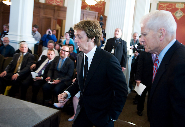 Musician Paul McCartney, left, arrives with to a news conference with Librarian of Congress James Billington, to announce that the former Beatle had won the Library of Congress Gershwin Prize for Popular Song, June 2, 2010.