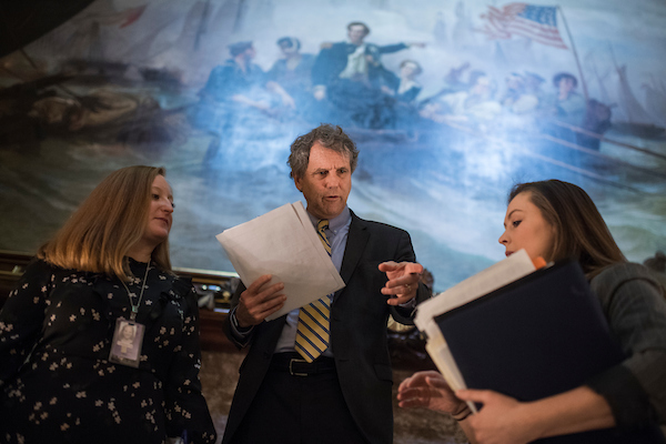 UNITED STATES - NOVEMBER 27: Sen. Sherrod Brown, D-Ohio, talks with aides before the Democratic Senate policy luncheons in the Capitol on November 27, 2018. (Photo By Tom Williams/CQ Roll Call)