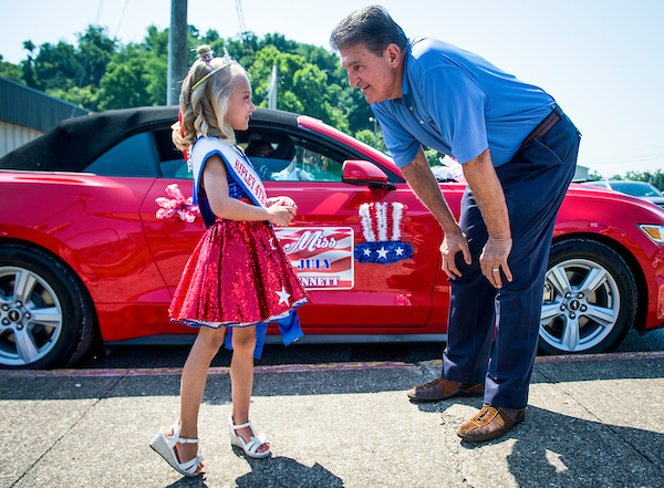 July 4: Sen. Joe Manchin, D-W.Va., chats with Little Miss 4th of July before the start of the Ripley 4th of July Grand Parade in Ripley, West Virginia Wednesday July 4, 2018. (Photo By Sarah Silbiger/CQ Roll Ca