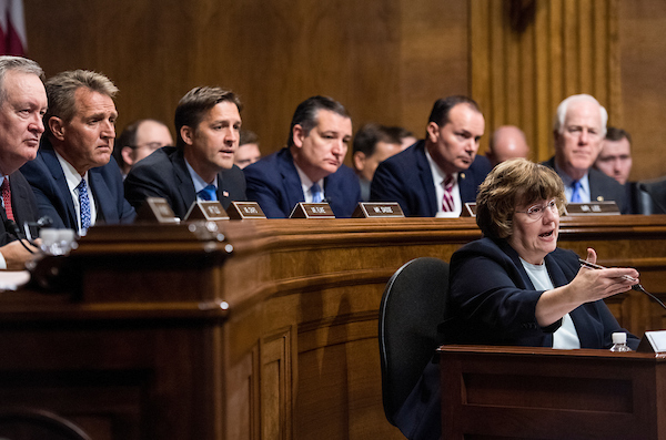SEPTEMBER 27: Rachel Mitchell, counsel for Senate Judiciary Committee Republicans, questions Dr. Christine Blasey Ford as Senators, from left, Mike Crapo, R-Idaho, Jeff Flake, R-Ariz., Ben Sasse, R-Neb., Ted Cruz, R-Texas, Mike Lee, R-Utah., and John Cornyn, R-Texas, listen during the Senate Judiciary Committee hearing on the nomination of Brett M. Kavanaugh to be an associate justice of the Supreme Court of the United States, focusing on allegations of sexual assault by Kavanaugh against Christine Blasey Ford in the early 1980s. (Photo By Tom Williams/CQ Roll Call/POOL)