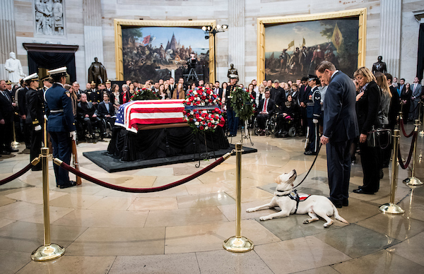 UNITED STATES - DECEMBER 4: Former Secretary of Homeland Security Tom Ridge looks down as Sully, former US President George H. W. Bush's service dog, visits the Capitol Rotunda as the former president lies in state Tuesday, December 4, 2018. (Photo By Bill Clark/CQ Roll Call)