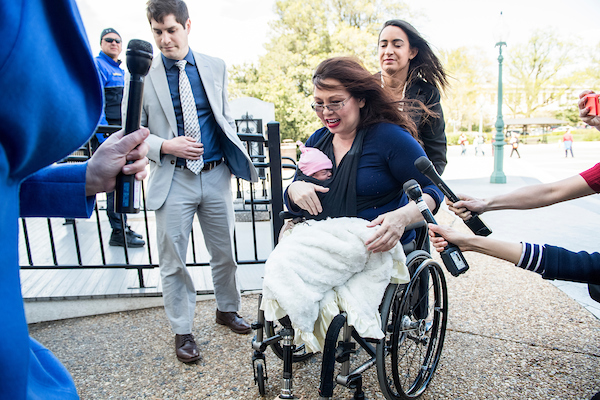 Sen. Tammy Duckworth, D-Ill., arrives with her newborn baby Maile to cast a vote on the Senate floor on Thursday, April 19, 2018. (Photo By Bill Clark/CQ Roll Call)
