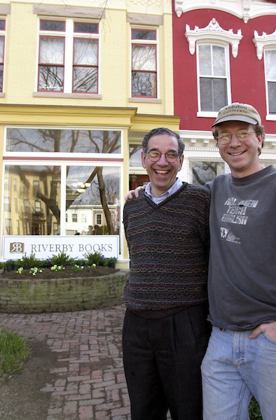 5riverby022801 -- Father and son co-owners Steve, left, and Paul Cymrot in front of Riverby Books on East Capitol Street.